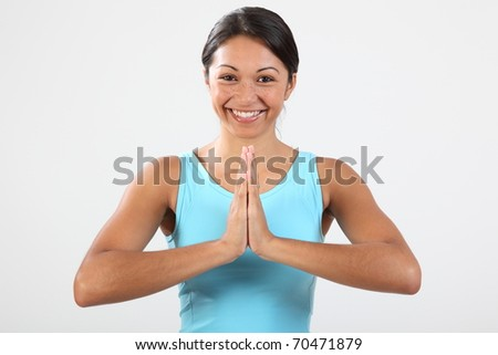 Big smile from young woman in exercise routine - stock photo