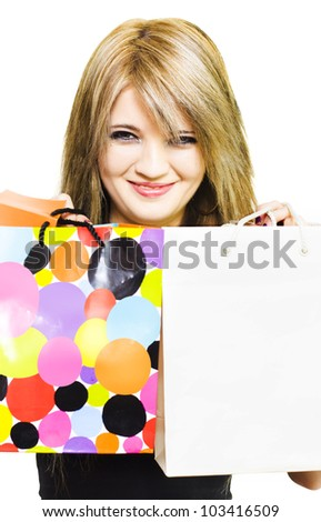 Big smiles after fun day shopping, a pretty blonde girl shows her store bags full of retail goodies, with copy space - stock photo
