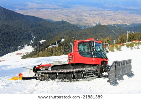 Big snow groomer equipment in snowy mountain