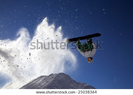 Big snowboard jump with bright blue sky and snow