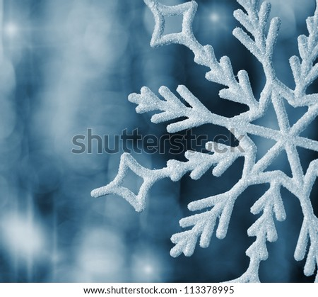 Big snowflake blue toned. Very blurred background - stock photo