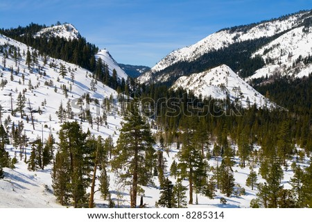 Big snowy mountains next to Lake Tahoe in Winter - stock photo