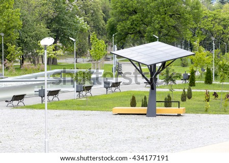 Big solar station/panel in a park. Environmentally friendly and ecological business. Green energy. - stock photo