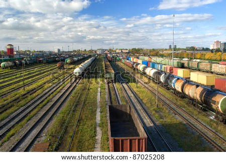 Big sorting station with freight trains in summer day - stock photo