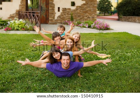big sports family on the grass in the park - stock photo