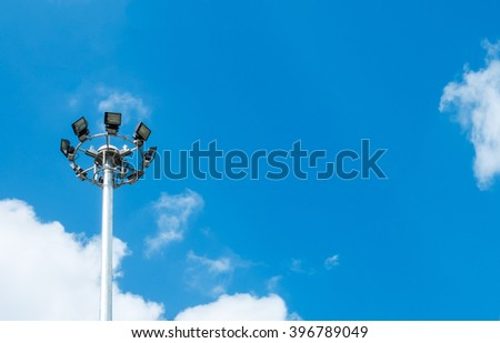 Big Spotlight Tower at The Corner on Blue Sky with Copyspace to input Text - stock photo