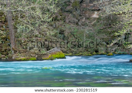 Big Spring in Missouri displaying spring colors and new foliage. - stock photo