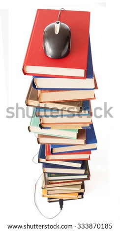 Big stack of old antique books with computer mouse on top isolated on white background/ E-book concept - stock photo