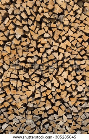 Big stack of wood, firewood, background texture
