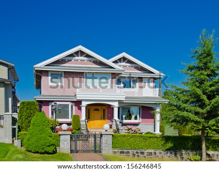 Big standard middle class house in a residential neighborhood. Vancouver, Canada - stock photo