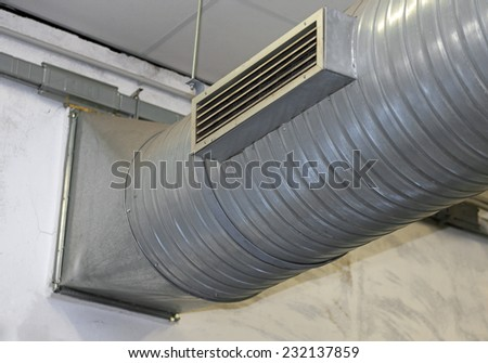 big steel pipe of air conditioning and heating in a factory - stock photo