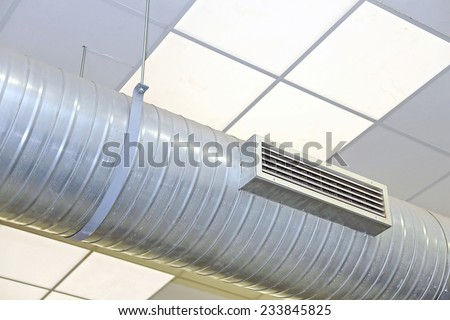 big steel tube of air conditioning and heating in an industrial setting - stock photo