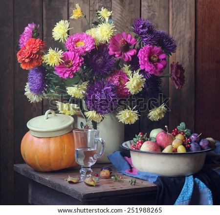 big still life with autumn flowers and fruits - stock photo