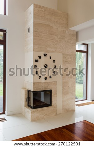Big stone modern fireplace in new empty living room - stock photo