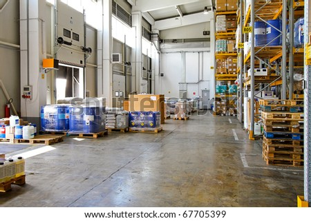 Big storehouse interior with merchandise for distribution - stock photo