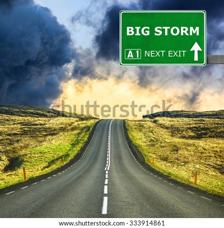 BIG STORM road sign against clear blue sky - stock photo