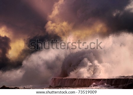 Big storm wave against lighthouse of Vila do Conde, north of Portugal (enhanced sky) - stock photo