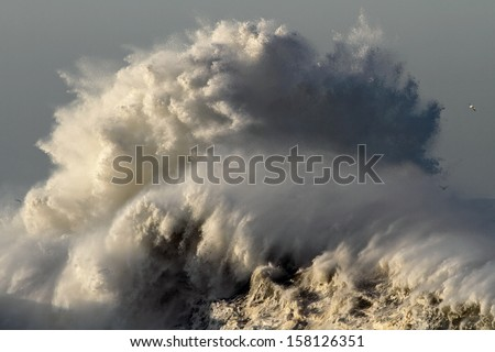 Big stormy waves crashing over Portuguese Coast - stock photo