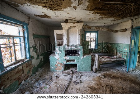 big stove in wooden cottage in small abandoned village called Stechanka, Chernobyl Nuclear Power Plant Zone of Alienation, Ukraine - stock photo
