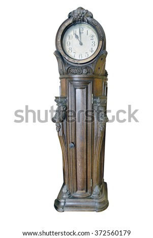 Big striking clock of 18th century. Beautiful craftsmanship example of German engravers on wood. Clipping path on the white background