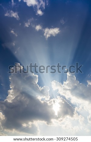 Big sunbeam coming out of clouds - stock photo