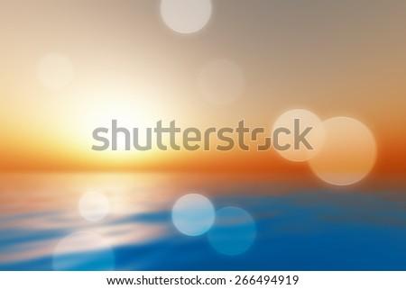big sunset over calm sea blurred - stock photo
