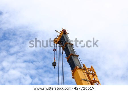 Big supper construction crane for heavy lifting on blue sky background - stock photo