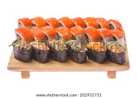 Big Sushi and roll set on wooden board isolated on white background
