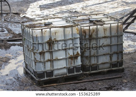 Big Tank contain crude oil that draw from oil spill accident on Ao Prao Beach at Samet island on July 31,2013 in Rayong,Thailand. - stock photo