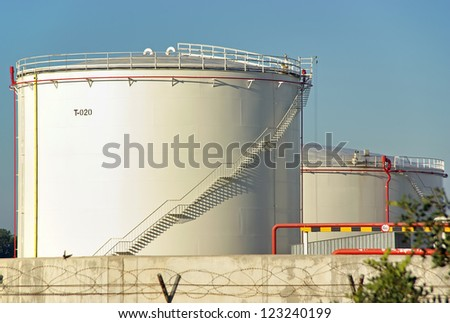 Big tank used to store fuel in a power plant - stock photo
