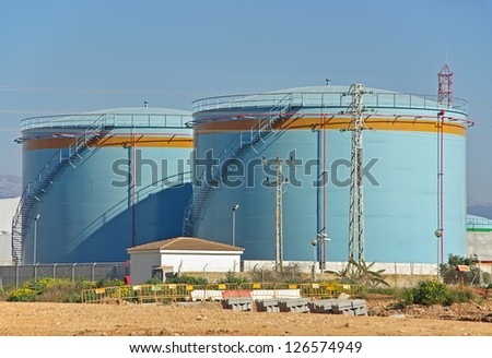Big tanks uses to store fuel in a power plant - stock photo