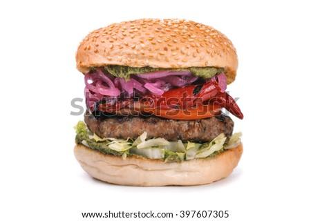 Big tasty hamburger burger with pesto isolated on white background - stock photo