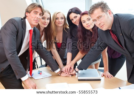 big team of business employees is showing their coherence - stock photo