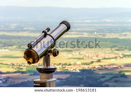 Big telescope on the point of view in Alsace hills - stock photo