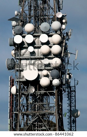 Big television and radio tower with several parabolic antenna on high quote (mountain) - Roncola (Italy) - stock photo