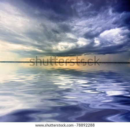 Big thundercloud over sea - stock photo