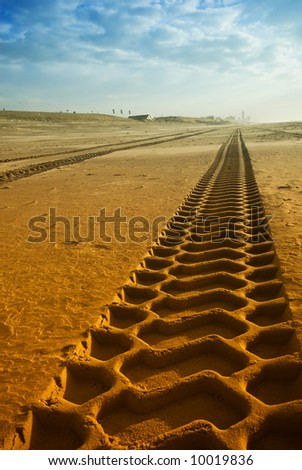 big tire tracks on the beach - stock photo