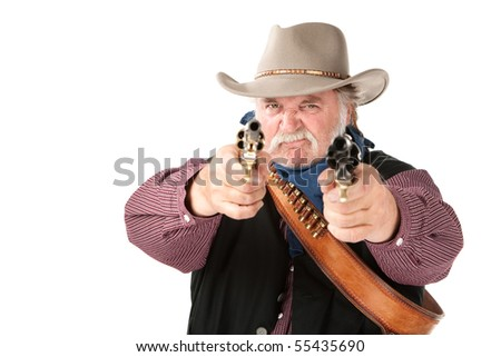 Big tough cowboy with leather holster pointing two pistols - stock photo