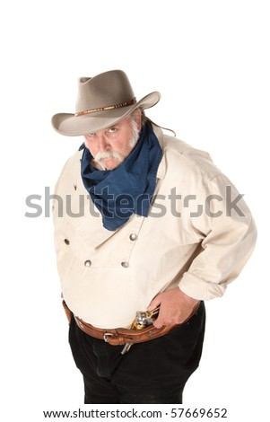 Big tough cowboy with moustache and pistol in belt