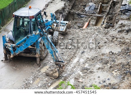 Big tractor on construction road - stock photo