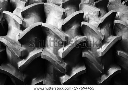 Big tractor rubber tire - stock photo