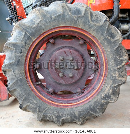 Big tractor wheel - stock photo
