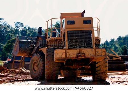 Big tractor working on a site. a great image for your job.