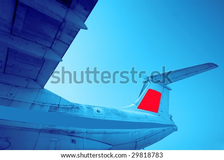 big transport plane on  background of  blue sky,  sunny day