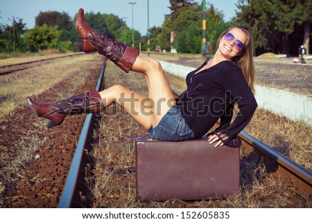 Big travel / Beautiful young woman waiting for a train