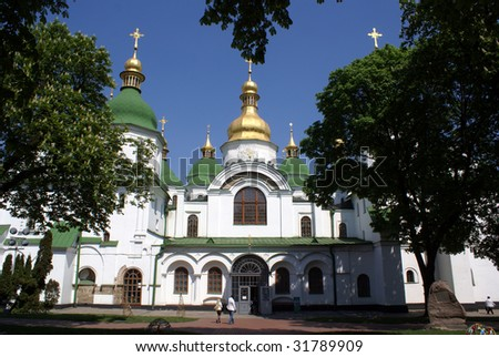 Big trees and church in Sophia monastery in Kiev