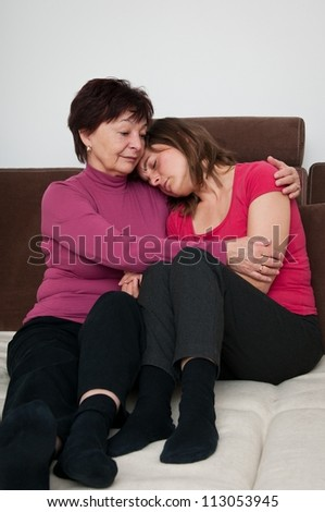 Big troubles - senior mother comforts daughter