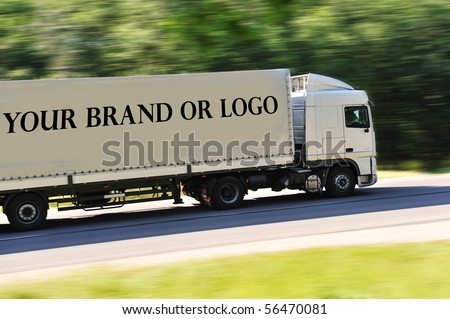 Big truck photographed from back side, no logo except great place for your logo or name of the brand - stock photo