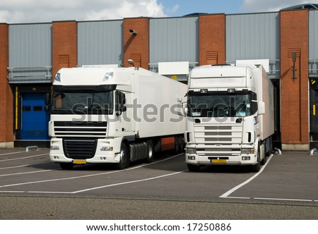 big trucks at a loading dock