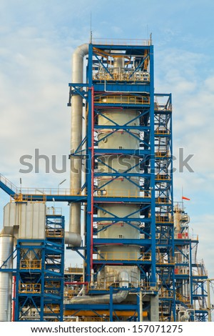 Big tube and blue iron structure in plant - stock photo